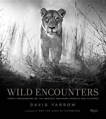 Wild encounters ; iconic photographs of the world's vanishing animals and cultures