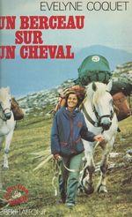 Un berceau sur un cheval