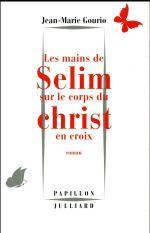 Les mains de Selim sur le corps du Christ en croix