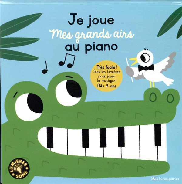 Je joue mes grands airs au piano